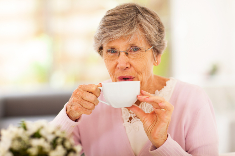 Image of senior woman drinking tea at home