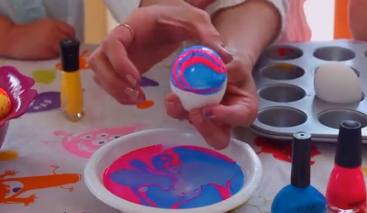 Marbleized Easter egg created with nail polish