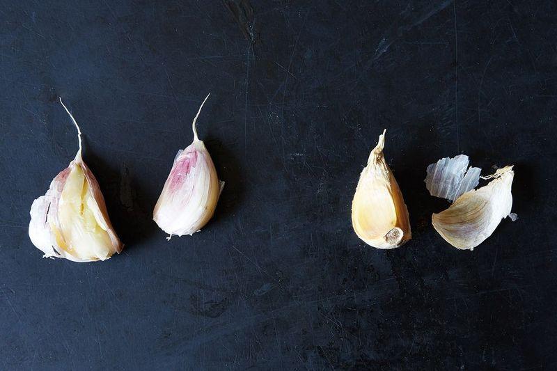 garlic cloves black background