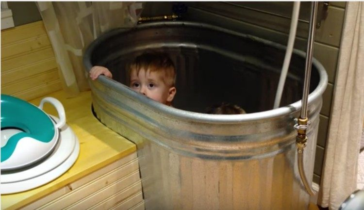 toddlers in an old-fashioned bath tub