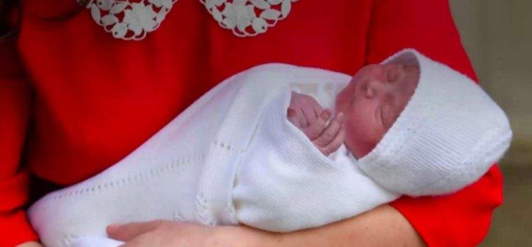 Duchess Kate holding Prince Louis