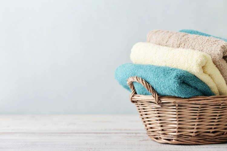 Basket of decorative bath towels.