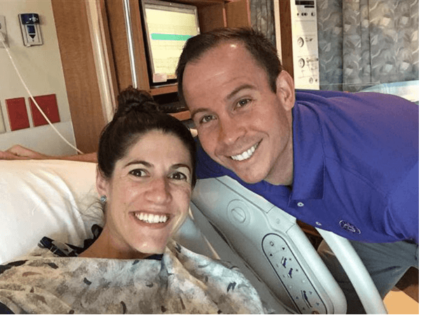 leah rodgers poses with her husband