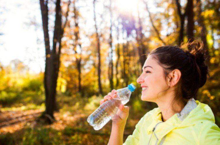 happy woman drinks water