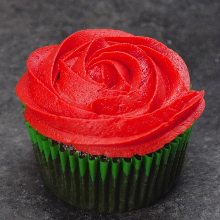 Cupcake topped with red frosting to look like rose