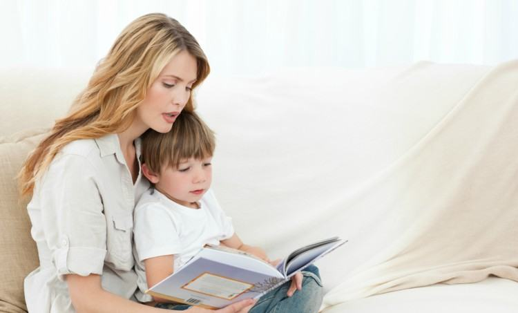 Mom reading with son.