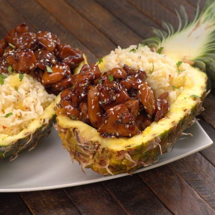 Teriyaki chicken pineapple boats on white plate