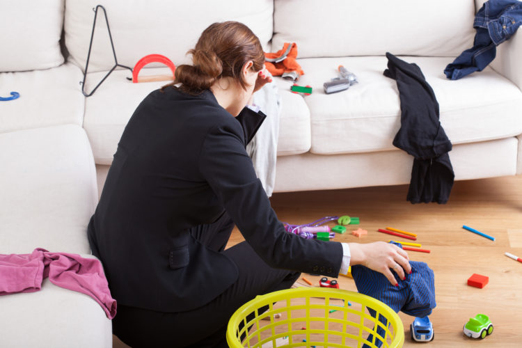 Image of mom stressed out with toys