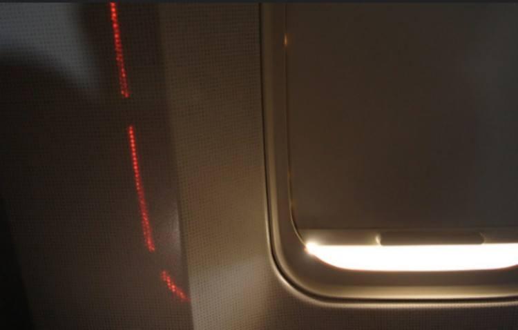 drawn window shade in airplane