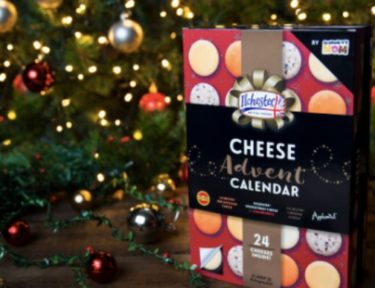 cheese advent calendar in front of a Christmas tree