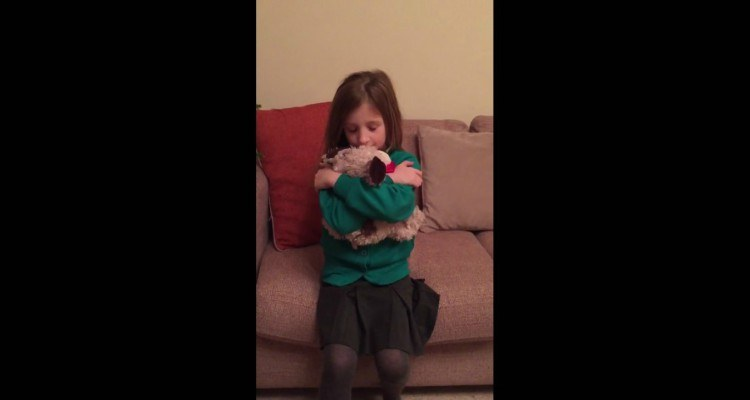 Image of girl with stuffed dog.