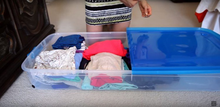 Flat under-bed storage for clothes.