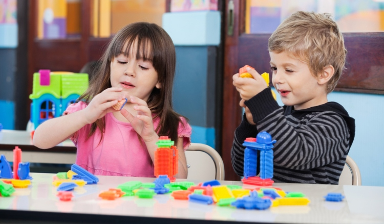 Image of little children playing with blocks in classroom