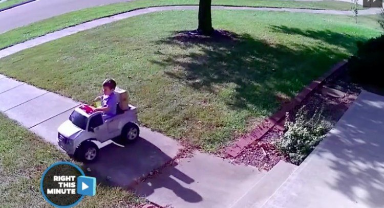 boy drives off with package
