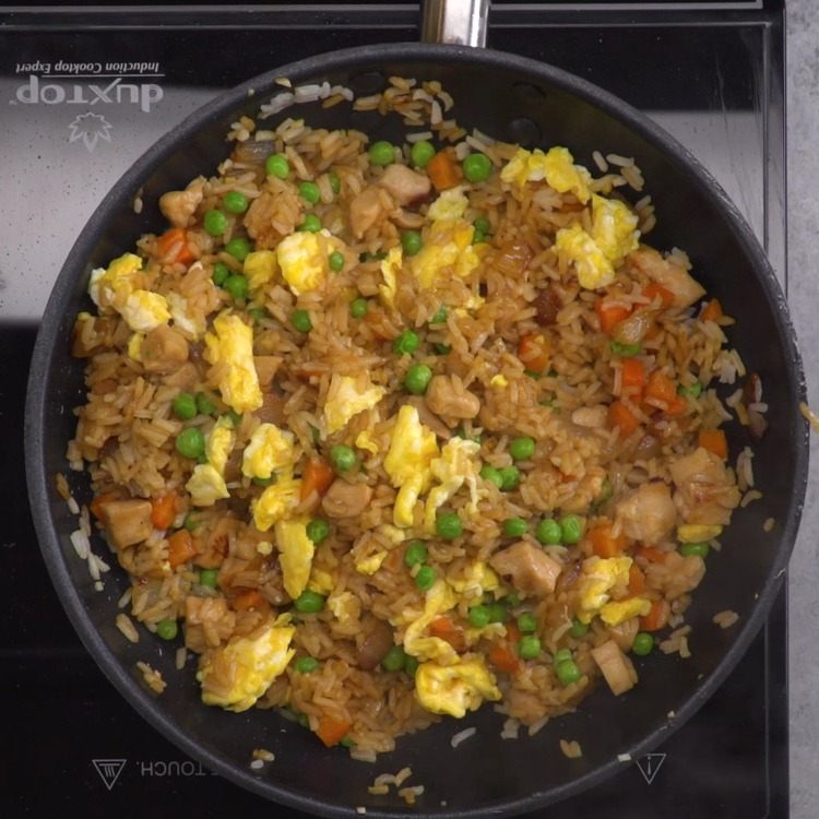 It's so easy to cook this spectacular restaurant-style chicken fried rice at home, you'll make it again and again. Also a great way to use up leftover rice!