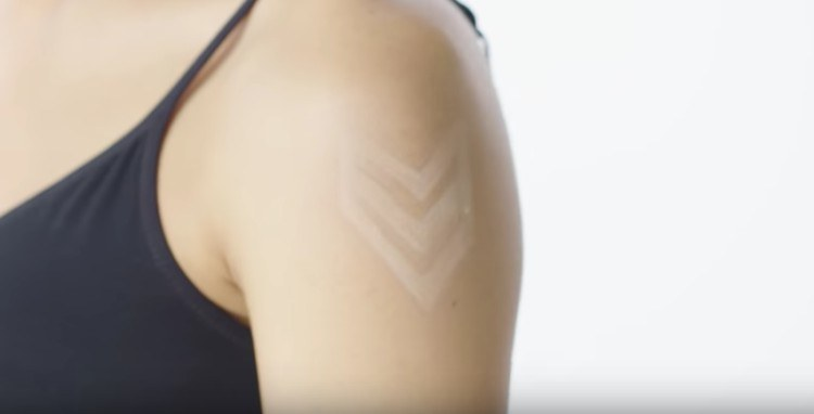 military tattoo on woman's arm