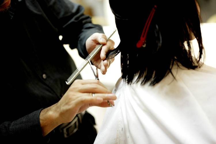 Image of stylist cutting hair.