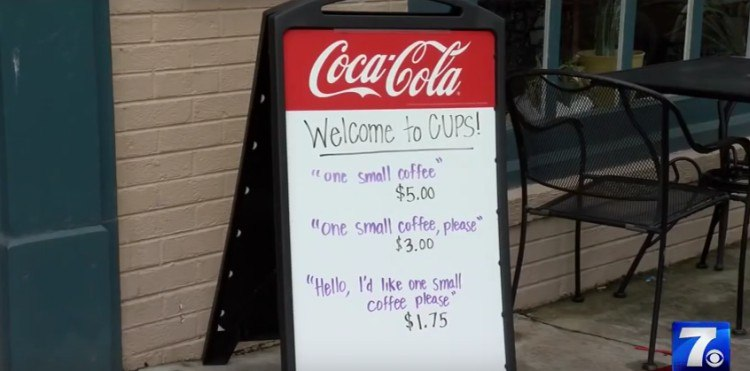 Close up on the call for manners coffee sign.