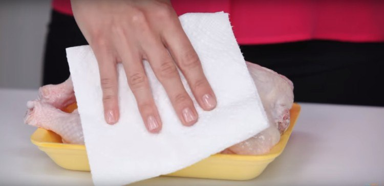 You should pat raw chicken with a paper towel to dry it.
