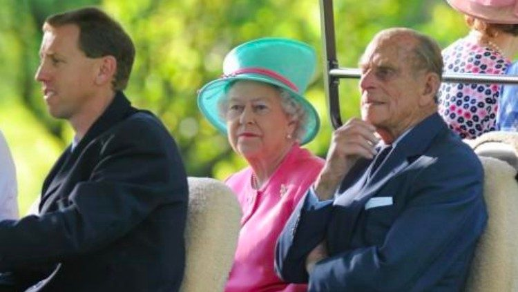 Queen and Prince Philip in golf cart