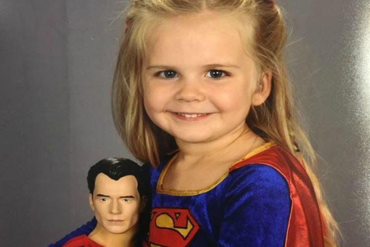 Kaylieann poses with Superman doll