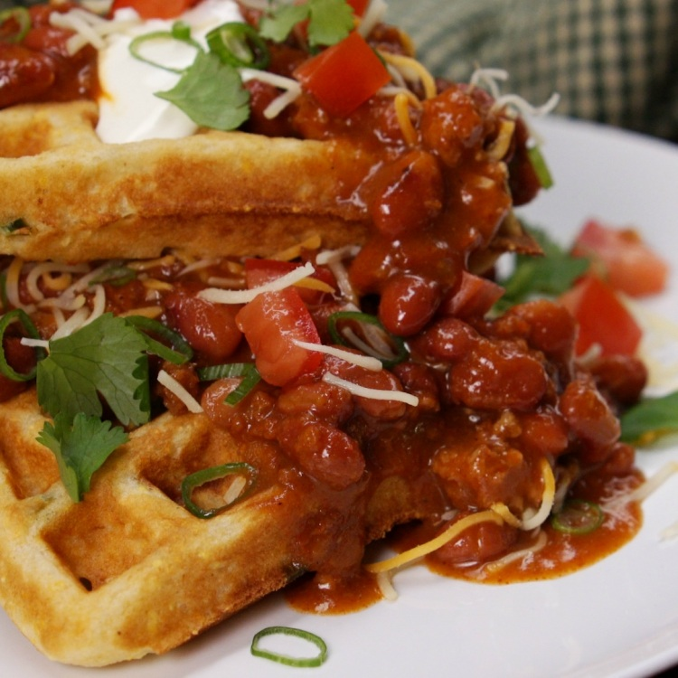Cornbread waffles topped with chili