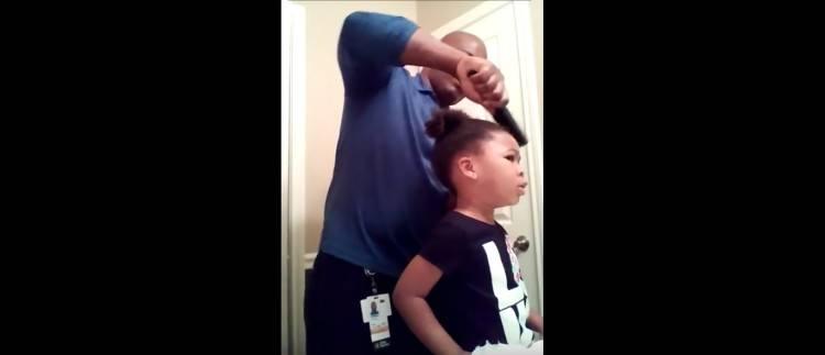 Pic of dad brushing daughter's hair.