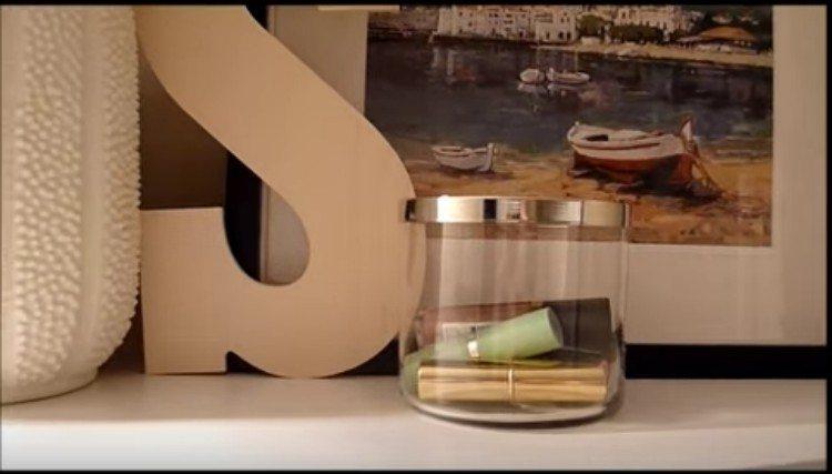 bathroom organizing jar filled with lipstick