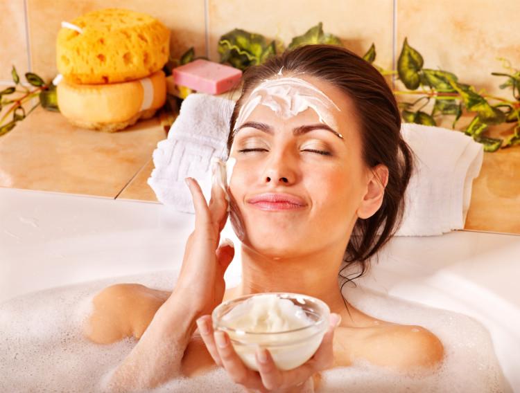Woman Takes Facial in Bath