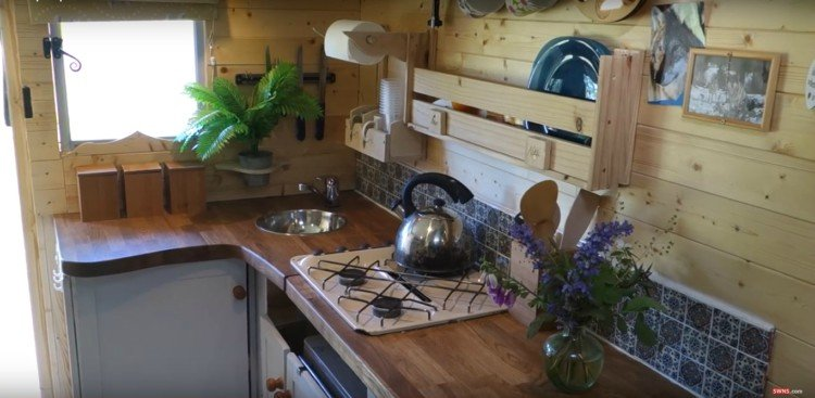 Kitchen area of couple's mobile home in a van.