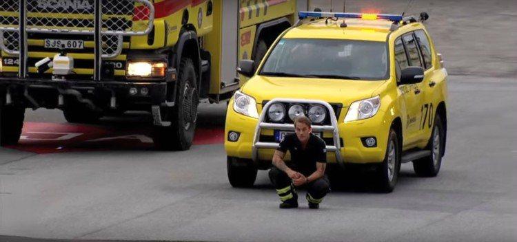 Image of firefighter kneeling.