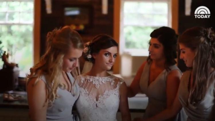 Hannah's bridesmaids help her get ready.