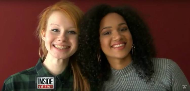 Image of twin teens smiling.