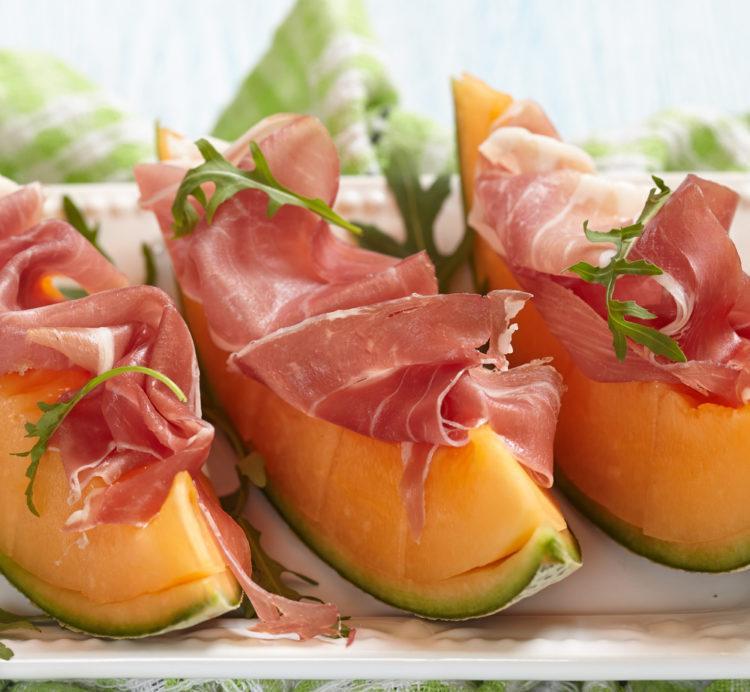 Fresh cantaloupe with prosciutto.