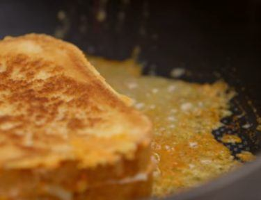Frying grilled cheese to give it cheese crust