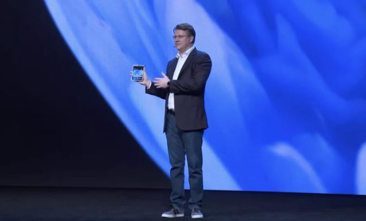 Image of man holding new foldable phone