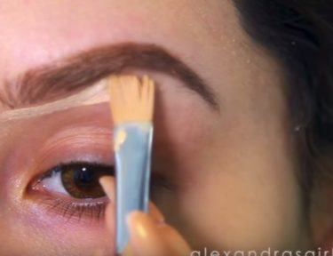 Applying eye shadow.