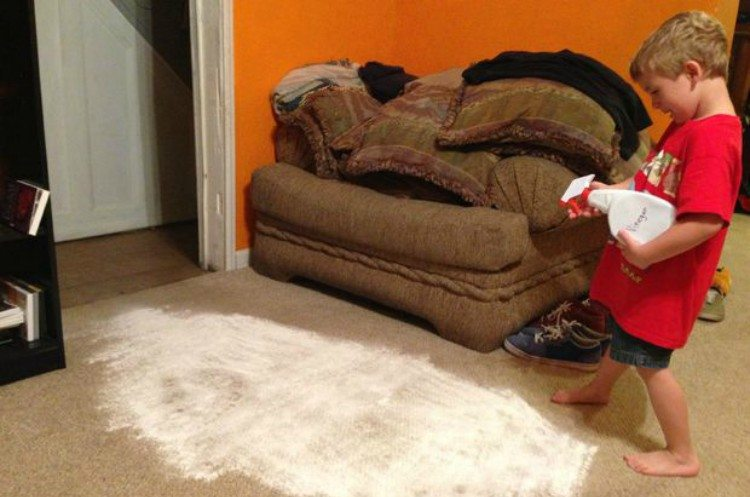 kid cleaning carpet