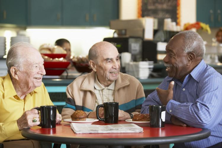 Senior men drinking tea together