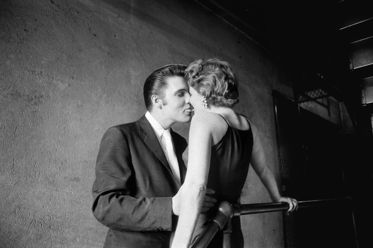 Elvis Presley kissing Barbara Grey backstage at The Mosque Theater
