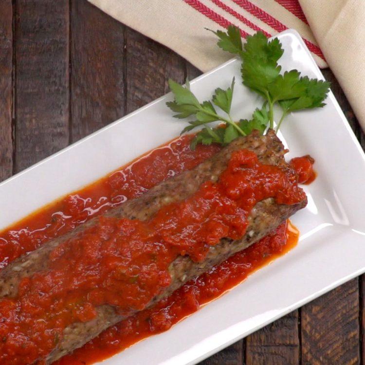 Pasta-Stuffed Meatloaf Roll marinara sauce parsley