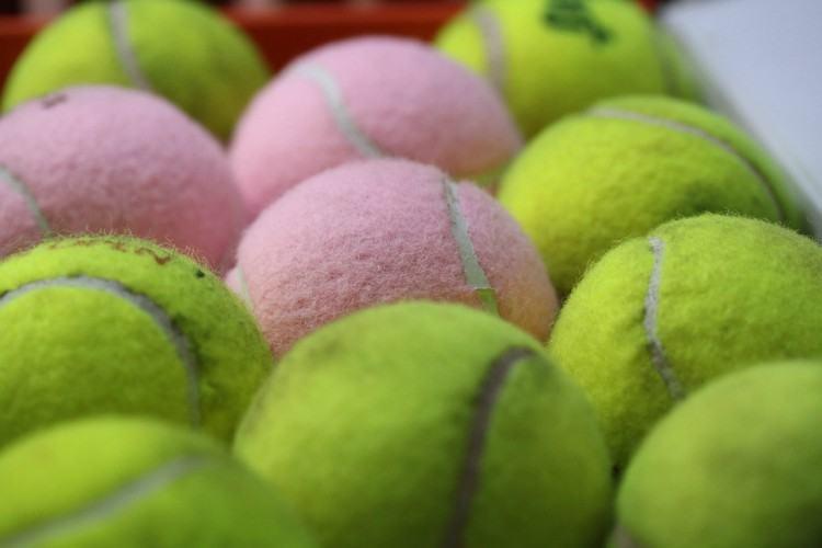 Image of arranged tennis balls.