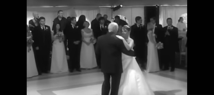 Image of father and daughter dancing at wedding.