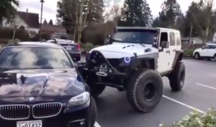 Image of jeep pushing BMW into spot
