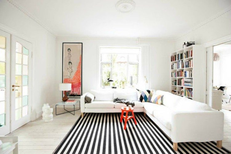 Striped floor makes a space seem longer.