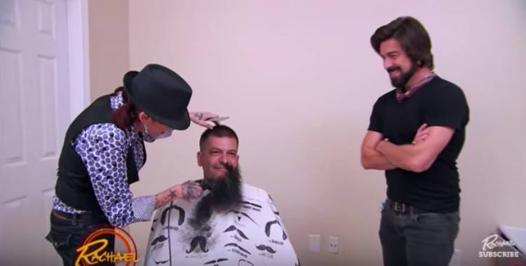 stylists shave off Travis' beard