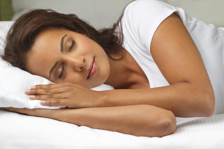 Woman sleeping in all white.