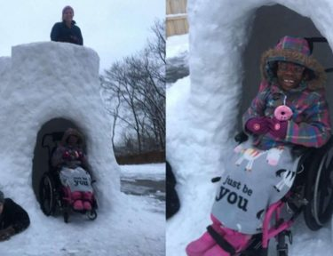 Image of girl in wheelchair playing in snow fort