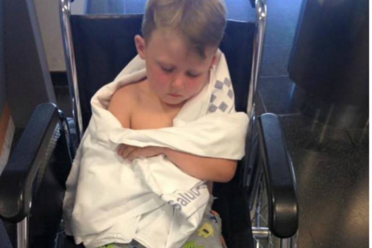 Image of boy recovering in wheelchair.