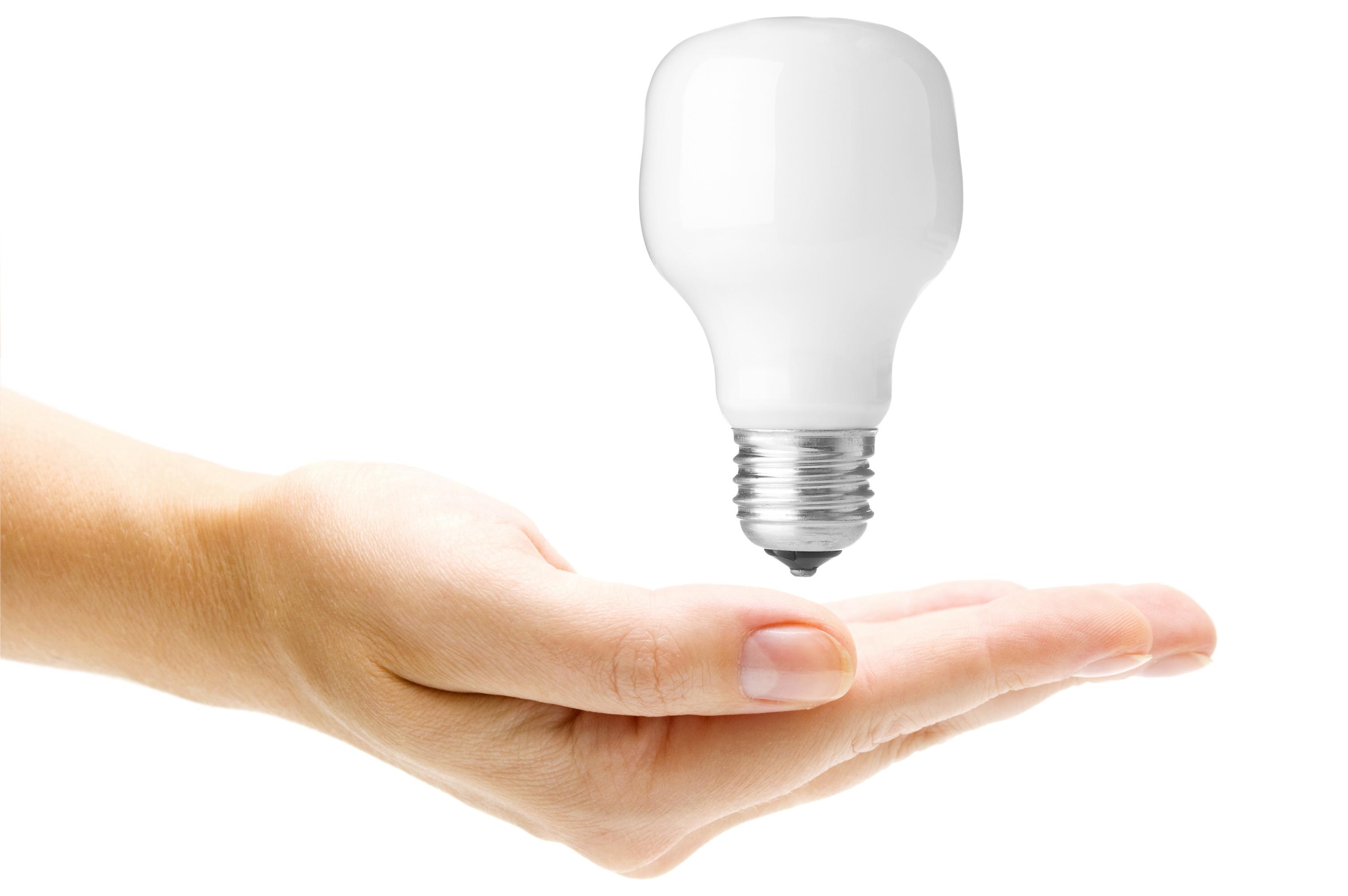 Energy saving light bulb in hand